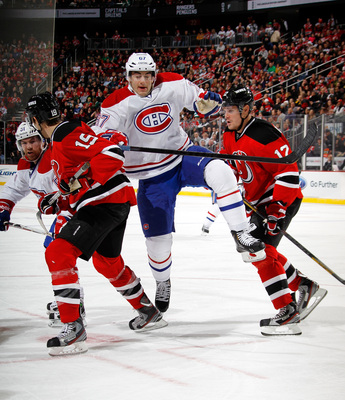 Montreal Canadien Max Pacioretty cuts between two New Jersey Devils.