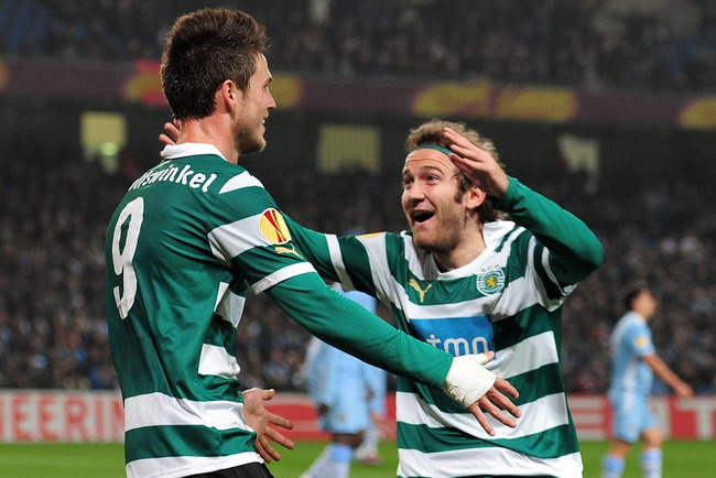 MANCHESTER, ENGLAND - MARCH 15:  Diego Capel of Sporting Lisbon (R) celebrates with goal scorer  Ricky van Wolfswinkel of Sporting Lisbon after he scored their second goal during the UEFA Europa League round of 16 second leg match between Manchester City