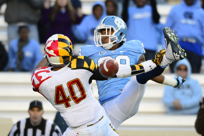 Nov 24, 2012; Chapel Hill, NC, USA; Maryland Terrapins defensive back Matt Robinson (40) breaks up a pass intended for North Carolina Tar Heels wide receiver Erik Highsmith (88) in the second quarter at Kenan  Stadium. Mandatory Credit: Bob Donnan-USA TOD