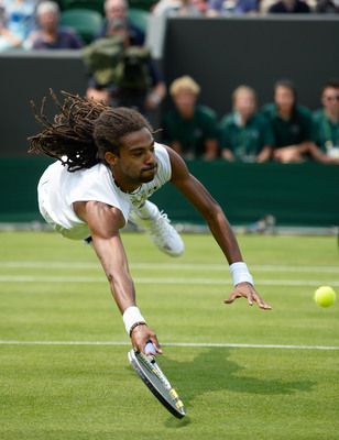 Dustin Brown flies to a volley during Wimbledon 2013.