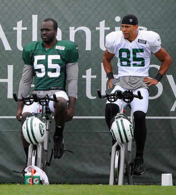 Ricky Sapp (left) shares a moment with Chaz Schilens during training camp 2012.