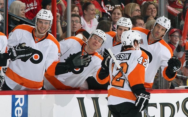 OTTAWA, CANADA - APRIL 27: Jason Akeson #42 of the Philadelphia Flyers celebrates his first goal in his first career NHL game with team mates Matt Konan #34, Brandon Manning #32 and Andreas Lilja #6, during an NHL game against the Ottawa Senators, at Scot
