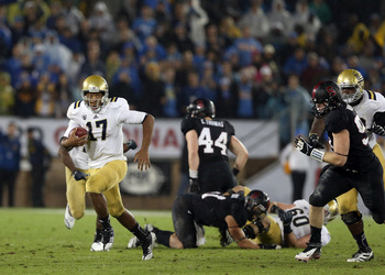 Hundley evading a Stanford defender