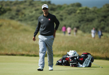 Adam Scott gets ready for a practice round at Muirfield.