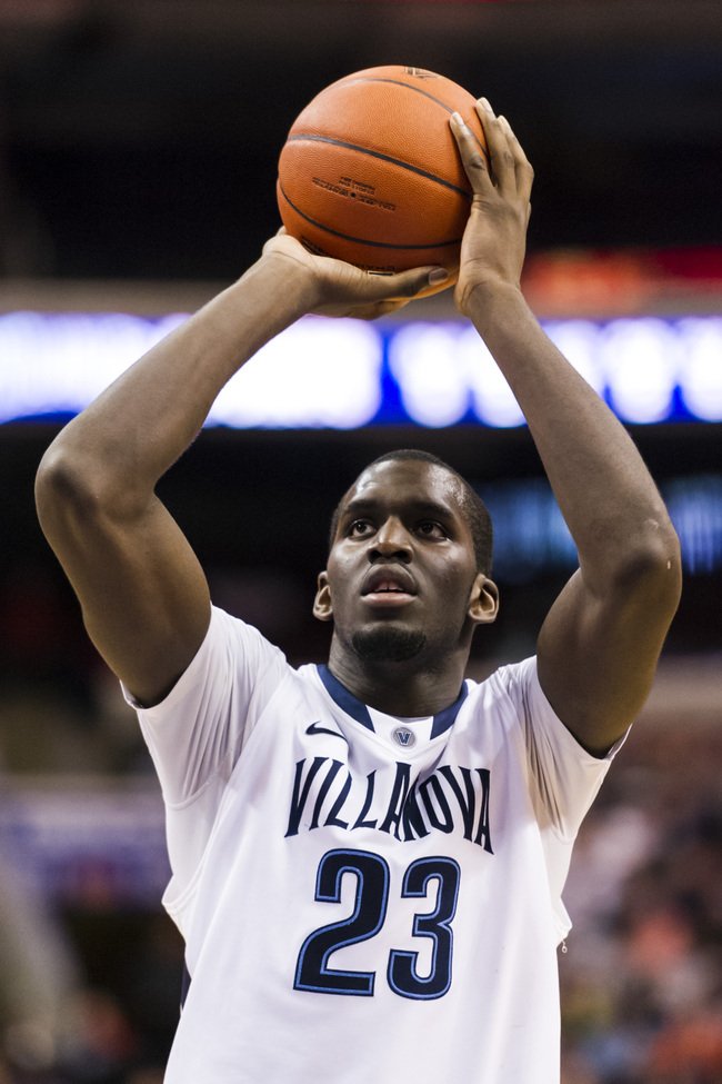 Mar 06, 2013; Philadelphia, PA, USA; Villanova Wildcats forward Daniel Ochefu (23) shoots a foul shot during the second half against the Georgetown Hoyas at the Wells Fargo Center. Villanova defeated Georgetown 67-57. Mandatory Credit: Howard Smith-USA TO