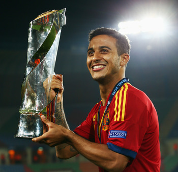 Thiago Alcantara holds the Under-21 European Championship trophy aloft