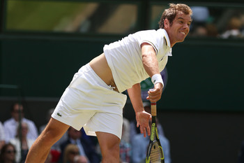 LONDON, ENGLAND - JUNE 29:  Richard Gasquet of France serves during the Gentlemen's Singles third round match against Bernard Tomic of Australia on day six of the Wimbledon Lawn Tennis Championships at the All England Lawn Tennis and Croquet Club on June