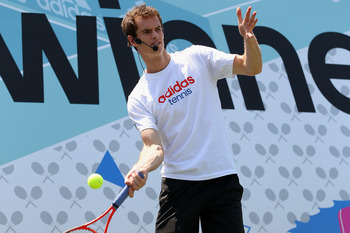 LONDON, ENGLAND - JULY 08:  Andy Murray of Great Britain in action during an event to meet fans following his victory in the Wimbledon Championships Gentlemen's Singles final match against Novak Djokovic of Serbia at the Black Prince Community Hub on July