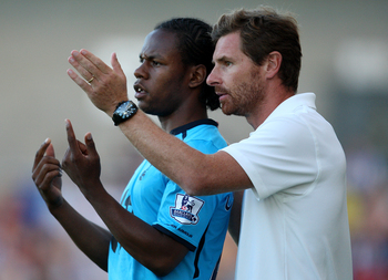 Villas-Boas talks tactics with Shaquile Coulthirst.