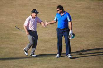Nick Faldo shakes with another great, Tom Watson.