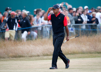 Tiger Woods taking the unhappy walk down the 18th fairway Sunday.