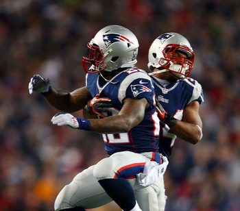 FOXBORO, MA - JANUARY 13:  Stevan Ridley #22 of the New England Patriots celebrates with Shane Vereen #34 after scoring a touchdown in the third quarter against the Houston Texans during the 2013 AFC Divisional Playoffs game at Gillette Stadium on January