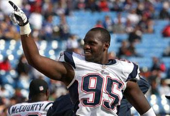 ORCHARD PARK, NY - SEPTEMBER 30: Chandler Jones #95 of the New England Patriots celebrates their impending victory during an NFL game against the Buffalo Bills at Ralph Wilson Stadium on September 30, 2012 in Orchard Park, New York. (Photo by Tom Szczerbo