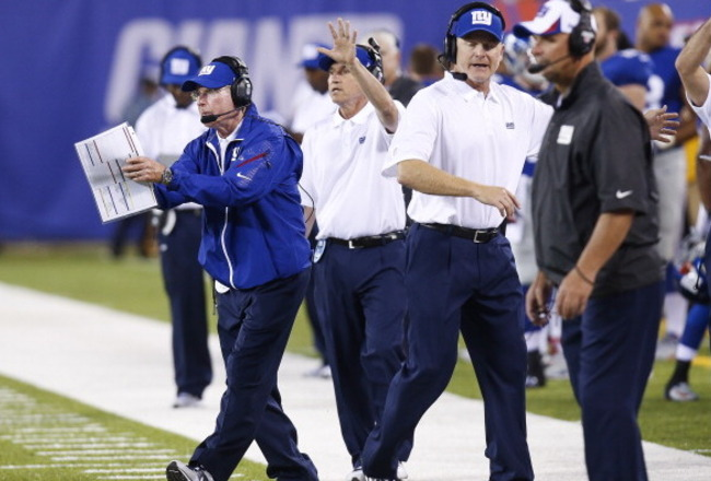 EAST RUTHERFORD, NJ - AUGUST 18:  Head coach Tom Coughlin of the New York Giants  works on the sidelines during their preseason game against the Indianapolis Colts at MetLife Stadium on August 18, 2013 in East Rutherford, New Jersey.  (Photo by Jeff Zelev