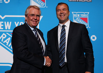 Glen Sather and Alain Vigneault.