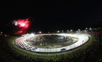 The four-wide parade lap with fireworks exploding overhead is part of the spectacle that is dirt track racing.