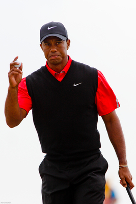 Tiger Woods has four wins in 2013 but has not won a major since 2008.