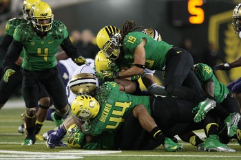 DeForest Buckner (#44) helpes out on a tackle