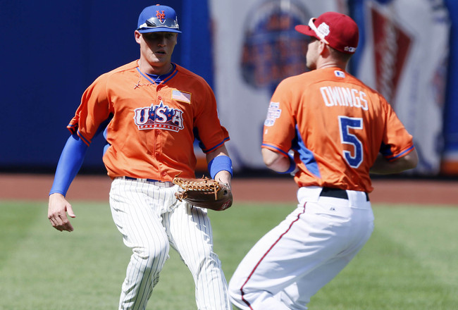 Jul 14, 2013; Flushing , NY, USA; USA outfielder Brandon Nimmo (left) watches as teammate Chris Owings catches a pop up during the 2013 All Star Futures Game at Citi Field. Mandatory Credit: William Perlman/THE STAR-LEDGER via USA TODAY Sports
