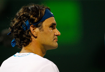 Roger Federer checks the scoreboard—Miami.