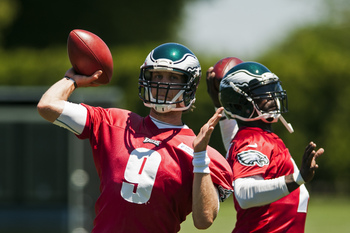 Nick Foles (left) and Michael Vick will compete in Philadelphia.