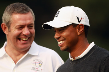 Hastings (left) with Tiger Woods