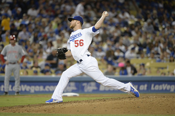 Jul 25, 2013; Los Angeles, CA, USA; Los Angeles Dodgers relief pitcher J.P. Howell (56) pitches against the Cincinnati Reds in the eighth inning at Dodger Stadium. Mandatory Credit: Richard Mackson-USA TODAY Sports