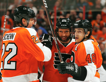 Current Montreal Canadien Daniel Briere (right) celebrates with former teammates Luke Schenn (left) and Maxime Talbot.