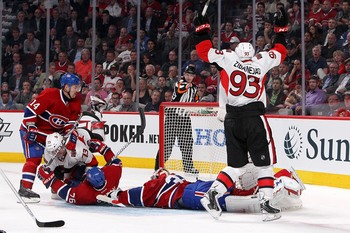 Ottawa Senator Mika Zibanejad (right) celebrates a goal against Montreal Canadien Carey Price.