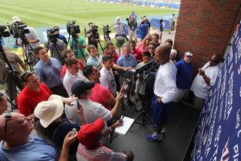 GM Jerry Reese addresses the press.