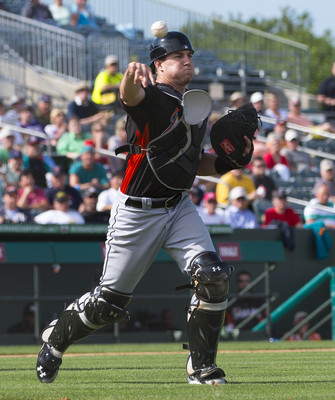 J.T. Realmuto has some work to do behind the plate before he'll be considered for a promotion to the majors.