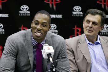 McHale, right, sits with newly acquired Dwight Howard (not Joe Smith).