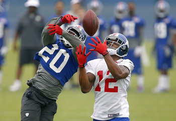 CB Prince Amukamara deflects a pass.
