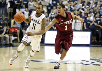 UConn's Ryan Boatright drives past Harvard's Siyani Chambers during a 57-49 win for the Huskies last season.