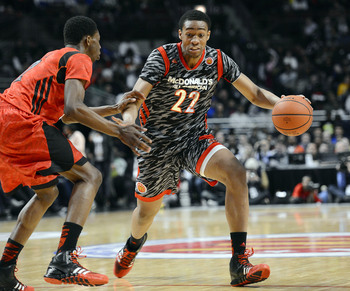 Jabari Parker drives against Andrew Wiggins during the McDonald's All-American game.