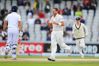 On your bike, son: Harris celebrates snaring Cook at Old Trafford to continue his dominance over the England top order in the previous two Tests