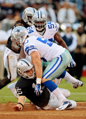 Sean Lee blitzes Matt Flynn and forces an early fumble in Oakland