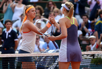 Victoria Azarenka congratulates Maria Sharapova at the 2013 French Open.
