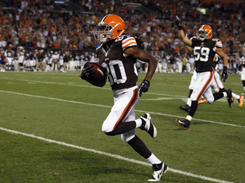 Travis Benjamin runs back a punt for a score versus St. Louis in Week 1 of the preseason.