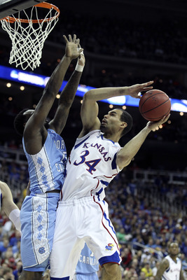 Perry Ellis as a junior could potentially be one of Tyus Jones' favorite targets if the star point guard picks Kansas.