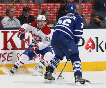 Montreal Canadiens center David Desharnais and Toronto Maple Leafs defenseman Carl Gunnarsson.