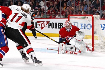 Then-Ottawa Senators winger Daniel Alfredsson takes a shot on Montreal Canadiens goaltender Carey Price.