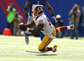 Fred Davis hauls in a pass from Robert Griffin III during a Week 7 matchup against the New York Giants in 2012.