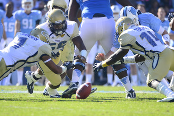 Johnson (1) had 9 tackles and a recovered fumble against UNC last year.