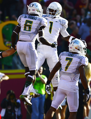 Oregon's De'Anthony Thomas (6), Josh Huff (1) and Keenan Lowe (7) celebrate after scoring a touchdown at USC in 2012.