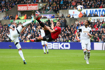 Poetry in motion: Van Persie beats Ashley Williams to scythe the ball home.