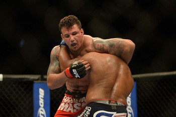 Frank Mir in a losing fight with Daniel Cormier.