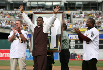 That's Phillips on the right, helping former teammate Rickey Henderson celebrate his induction into the Hall of Fame.