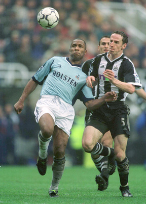 Ferdinand in action for Tottenham against Newcastle