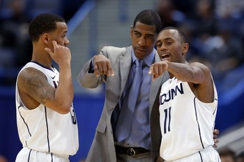 UConn coach Kevin Ollie talks to his two star guards last season.